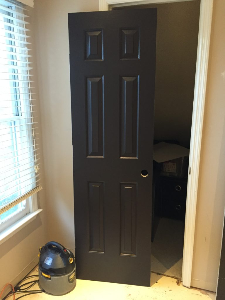 black doors, painted black, paint sprayer,
