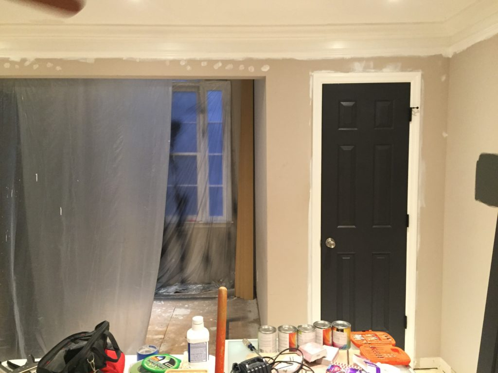 Room Makeover with painted black interior doors. and painted door hinges.