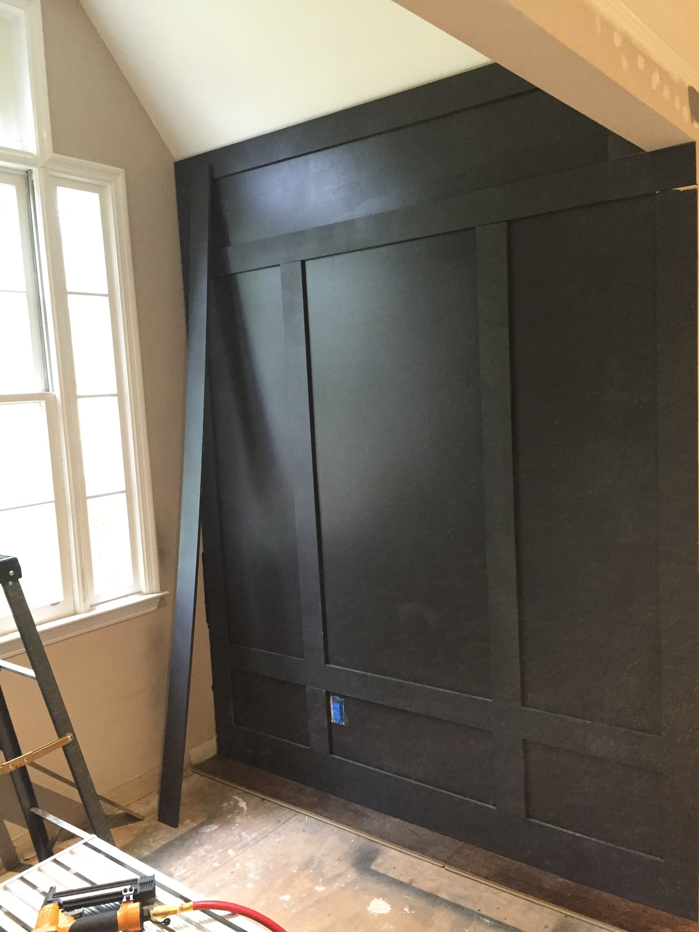 DIY board and batten walls for my bonus room makeover. Benjamin Moore Mopboard Black | Board and Batten | Wood trim detail
