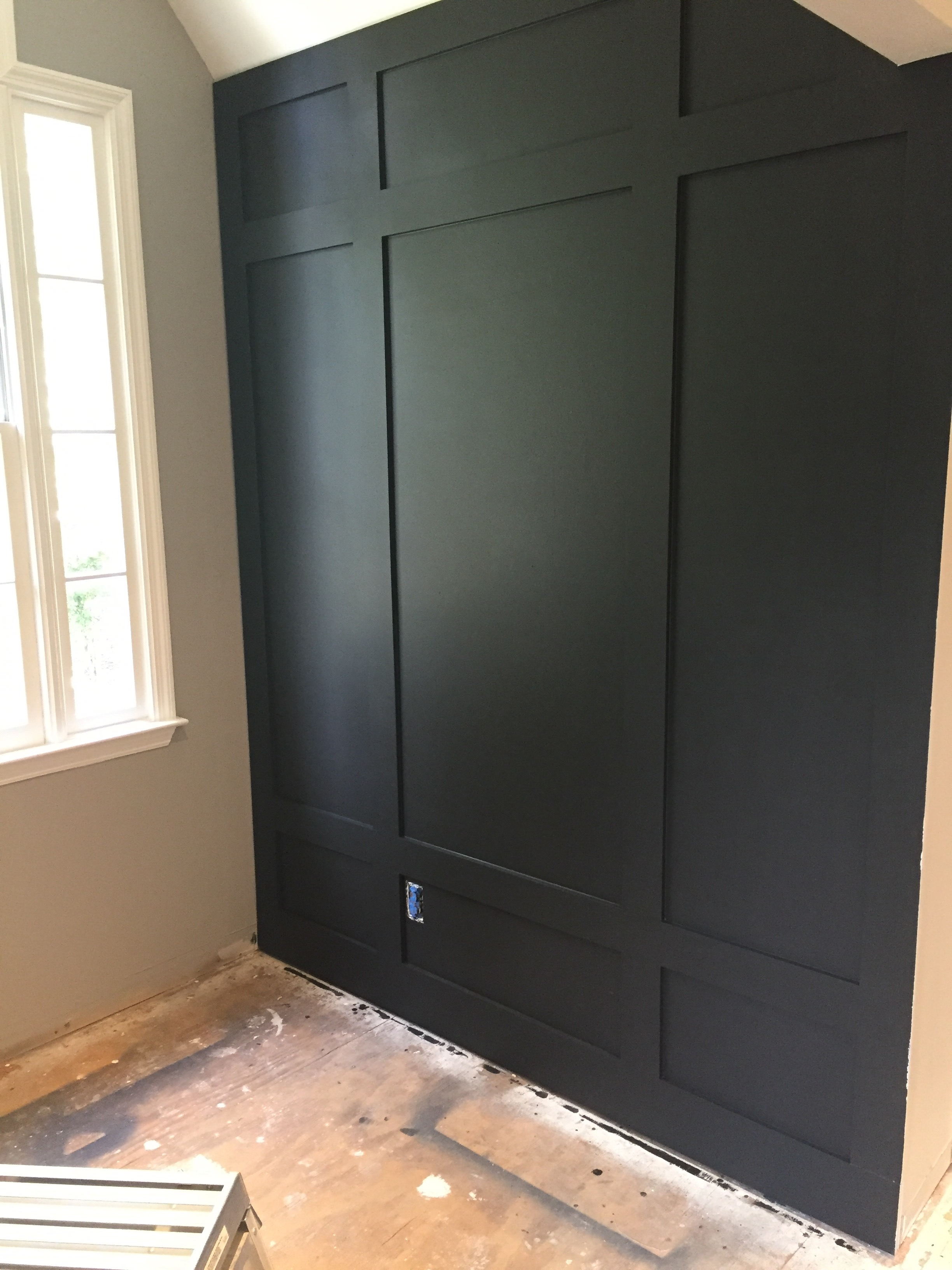 DIY board and batten walls for my bonus room makeover. Benjamin Moore Mopboard Black | Board and Batten | Wood trim detail | Before and after